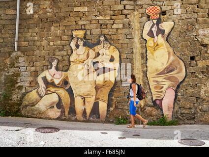 Murales in Orgosolo street, wall art painting, Sardinia, Italy - Stock Photo