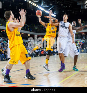 London, UK. 13th November 2015. London Lions player Nick Lewis (11) jumps up to the basket with Giants' Nathan Schall - Stock Photo
