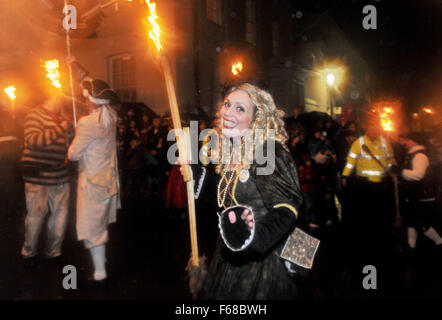 Young woman a member of South Street Bonfire Society procession at the Lewes Bonfire 2015 celebrations this evening - Stock Photo