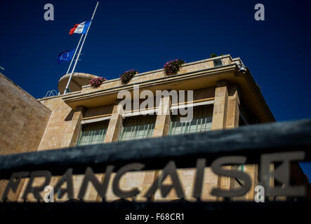 Jerusalem. 14th Nov, 2015. A French national flag and an European Union flag fly at half mast at Consulate General of France in Jerusalem to mourn the victims of a series of attacks in Paris, on Nov. 14, 2015. Credit:  Li Rui/Xinhua/Alamy Live News