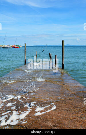 The harbour at Rhos-on-Sea, showing the main jetty. - Stock Photo