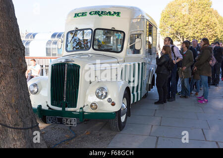 People queueing for ice cream from a 1950s Morris Commercial van, South Bank, London - Stock Photo