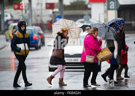 Aberystwyth Wales UK, Saturday 14 November 2015    People struggle avoid getting soaked on the streets of Aberystwyth - Stock Photo