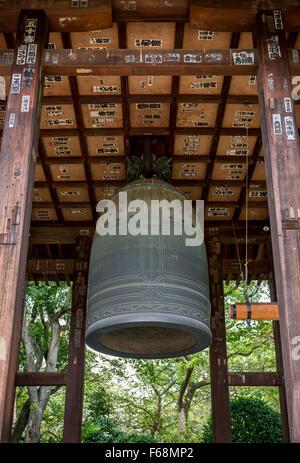 Bell inside the Zojo Ji shrine in Tokyo, Japan. - Stock Photo