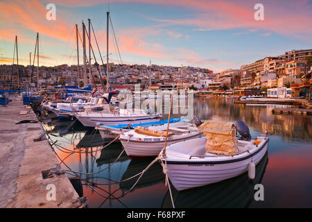Boats mooring at a pier in Mikrolimano marina in Athens, Greece - Stock Photo