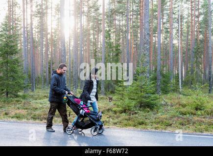 Family on a walk - Stock Photo