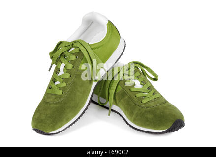 Green running shoes isolated on white background. Casual style sneakers. - Stock Photo