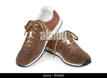 Brown running shoes isolated on white. Casual style sneakers. - Stock Photo