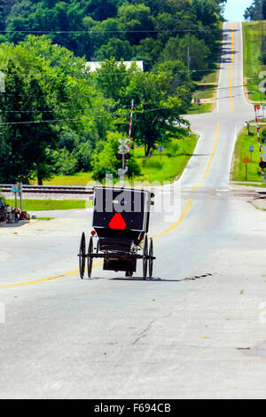 Amish horse and buggy on the road in a small rural community in Wisconsin - Stock Photo