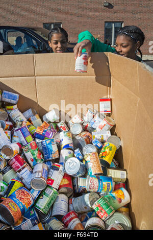 St. Clair Shores, Michigan USA. Volunteers pack food donated for needy families in the Detroit area in an annual - Stock Photo