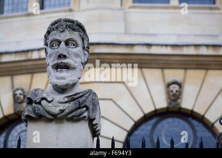 Carved stone busts on plinths outside Sheldonian theatre, Oxford, England - Stock Photo