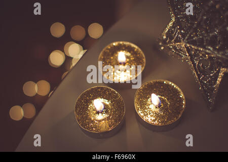 Christmas golden candles - Stock Photo
