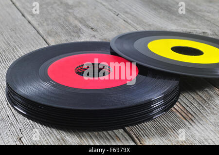 Photo of stack of old vinyl records on a wooden table - Stock Photo
