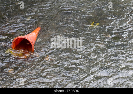 Traffic Cone in the water - Stock Photo
