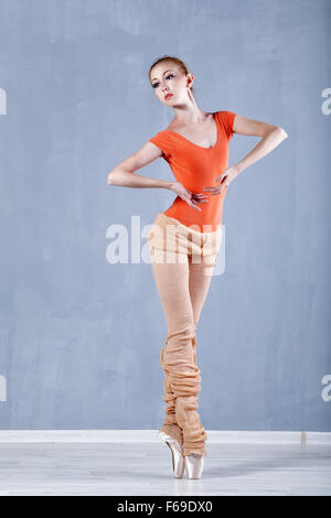 Classical ballet in the performance a slim ballerina. Girl rehearses dance. Girl stands on tiptoe. - Stock Photo