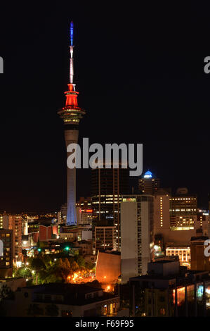 AUCKLAND NEW ZEALAND NOV 14 2015: Tonight Auckland's Sky Tower has lit up in the colours of the French flag in Auckland, - Stock Photo