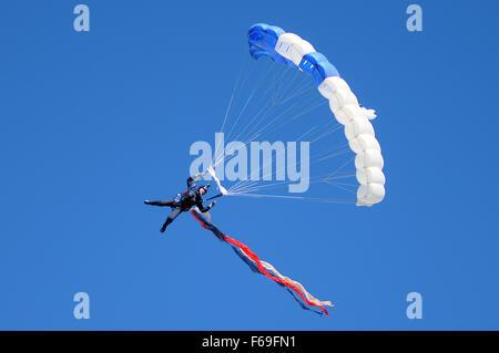 Colorado Springs, Colorado, USA. 14th Nov, 2015. An Air Force Academy Wings of Blue skydiver flies into the stadium - Stock Photo