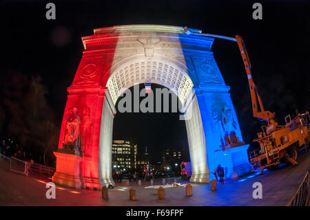 New York, NY - 14 November 2015 NYC  The arch in Washington Square Park lit up in blue, white and red, and a candlelight - Stock Photo