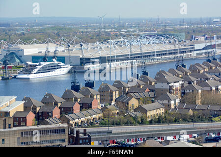London aerial view of modern homes & Excel Exhibition Centre built around Royal Victoria Dock part of London Docklands - Stock Photo