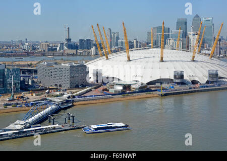 Looking down view from above River Thames loops behind O2 dome on Greenwich Peninsula Thames clipper & Canary Wharf - Stock Photo