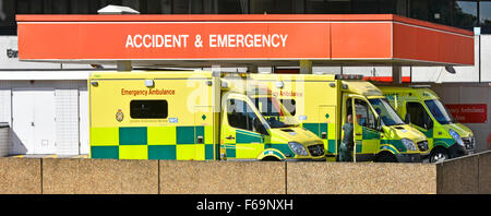 St Thomas Hospital Accident and Emergency department busy with ambulances in drop off bay and canopy Lambeth London - Stock Photo