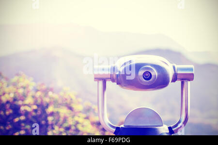 Vintage toned monocular pointed at horizon, shallow depth of field. - Stock Photo