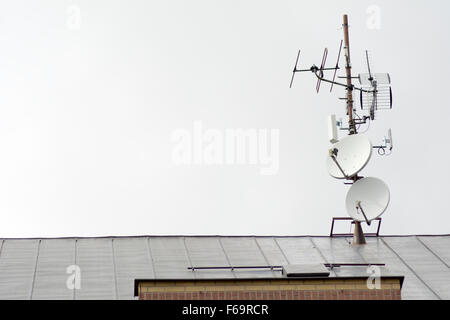 ... TV Antennas And Satellites On The Roof Of The House   Stock Photo