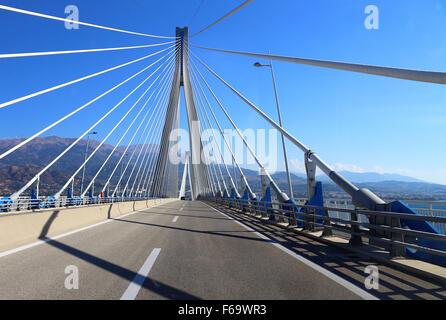 suspension bridge crossing Corinth Gulf strait, Patra, Greece. I - Stock Photo