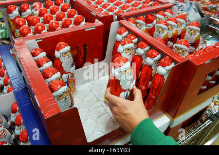 Chocolate Santa Clauses in a Supermarket - Stock Photo