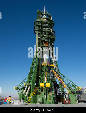 An Orthodox priest blesses the Soyuz rocket at the Baikonur Cosmodrome launch pad on Saturday Nov. 22, 2014, in - Stock Photo