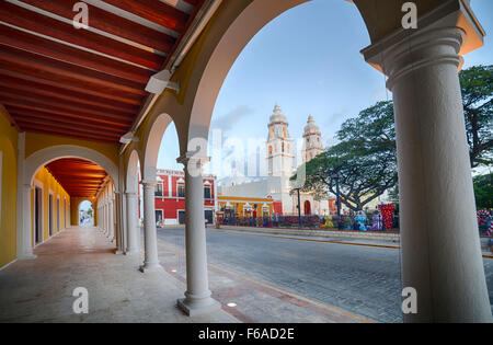 Plaza and cathedral of Campeche, Mexico as seen from the portales. - Stock Photo