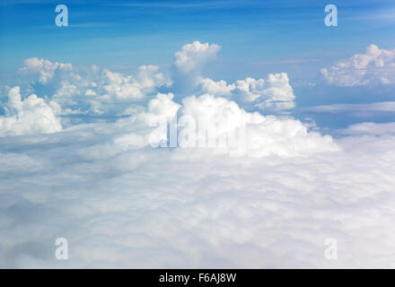 Panoramic view of cumulus clouds from above - Stock Photo