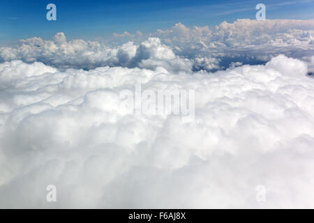 Blue sky with ornamental clouds - Stock Photo