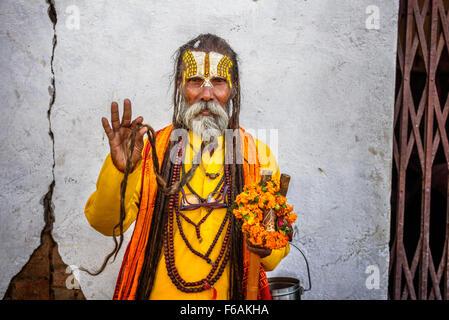 Wandering  Shaiva sadhu (holy man) shows his long beard - Stock Photo