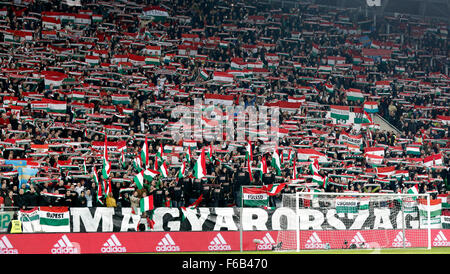 Budapest, Hungary. 15th November, 2015. Hungarian fans listen to the national anthem during Hungary vs. Norway UEFA - Stock Photo