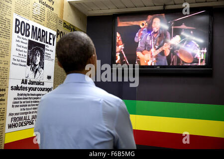President Barack Obama watches a video of Bob Marley during a visit to the Bob Marley Museum in Kingston, Jamaica, - Stock Photo