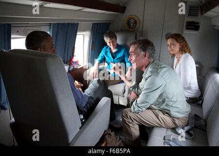President Barack Obama talks with Bill Nye, the Science Guy, Rep. Debbie Wasserman Schultz, D-Fla., and Interior Secretary Sally Jewell aboard Marine One en route to Miami International Airport following a visit to Everglades National Park, Fla. on Earth Day, April 22, 2015.