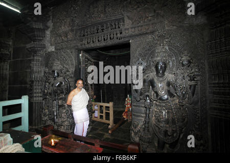 man standing - Intricate artwork at ancient hindu temple in Belur Karnataka - Stock Photo