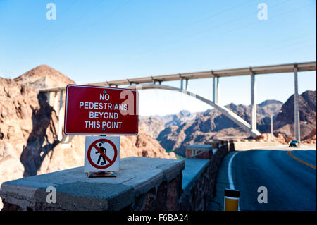Caution sign,Sign at the Hoover Dam - Stock Photo