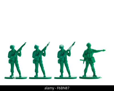 Several plastic soldiers in row, white background - Stock Photo