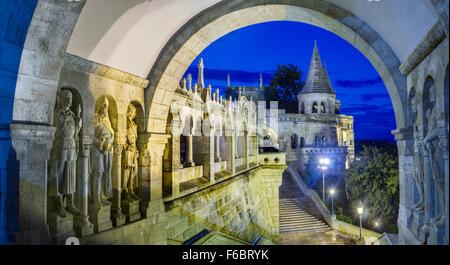 Statues along corridor at dusk, Fisherman's Bastion, Budapest, Hungary, - Stock Photo