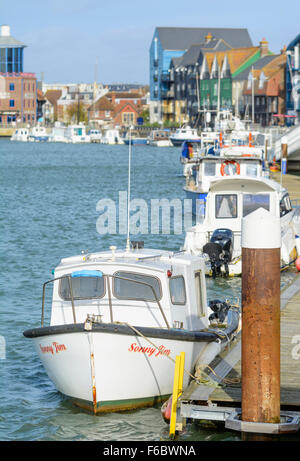 Boats moored up on the River Arun at Littlehampton, West Sussex, England, UK. - Stock Photo