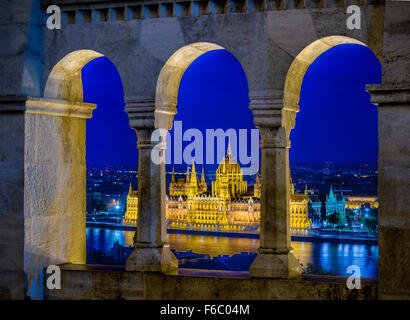 Parliament from the Fisherman's Bastion at dusk. Viewpoint over the city and the River Danube. Budapest, Hungary - Stock Photo