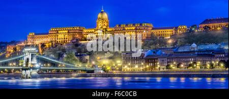 Hungary, Budapest, Chain Bridge and the Royal Palace illuminated, dusk - Stock Photo