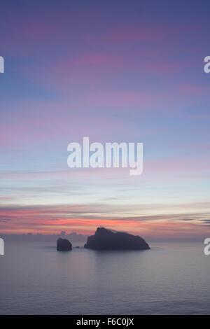 Sunrise silhouette of the island of Boreray in the St Kilda archipelago, United Kingdom - Stock Photo