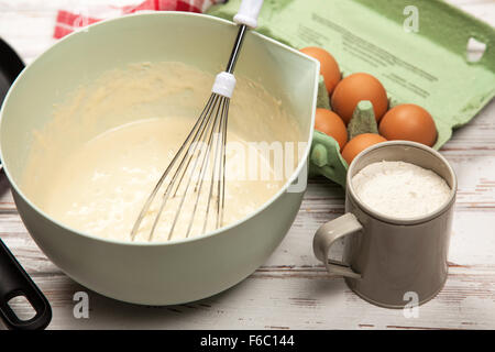 Preparing batter for pancakes - Stock Photo