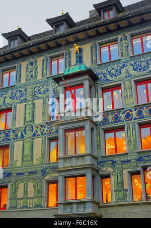 Exterior of the building with frescos and a figure of a golden bow boy in the old town center of Lucerne in Switzerland. - Stock Photo