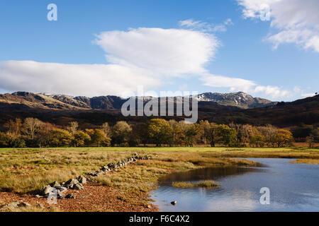 View across Llyn Dinas lake to Cnicht mountain in Snowdonia National Park in autumn. Nant Gwynant Gwynedd North Wales UK Britain
