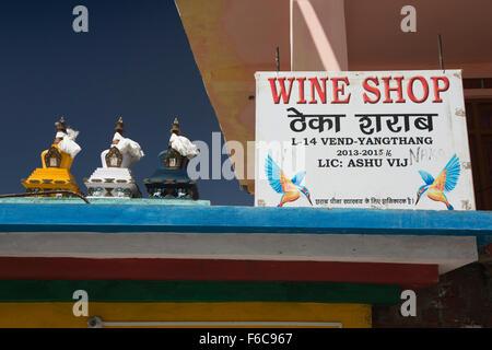 India, Himachal Pradesh, Yangthang, wine shop sign, advertising Kingfisher beer - Stock Photo