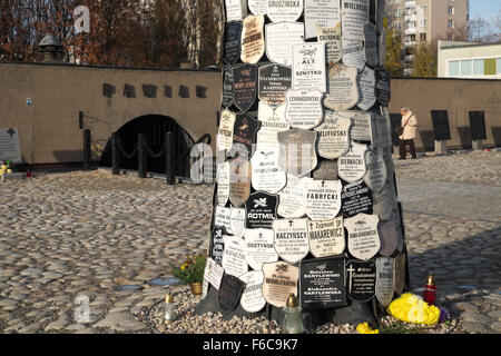 Warsaw Poland - Memorial tree at the entrance to the Pawiak prison used by the Germans during WW2 for torture and - Stock Photo